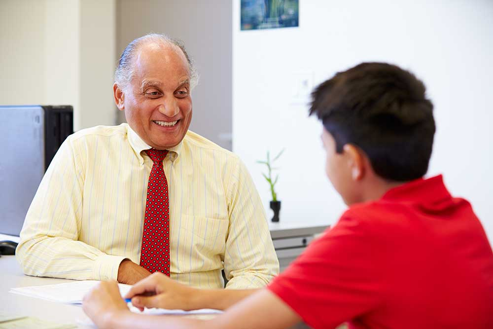 male teacher counseling student