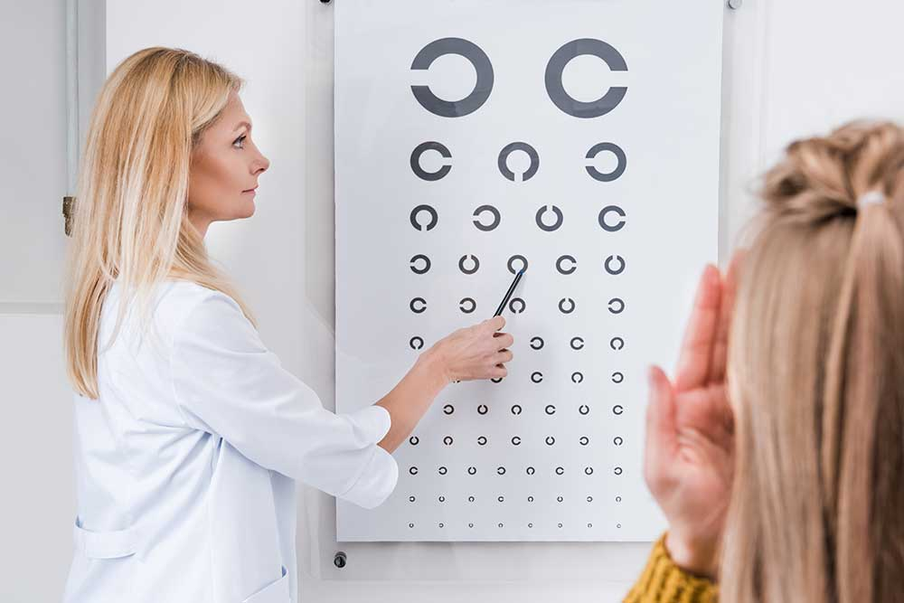 optometrist administering eye exam