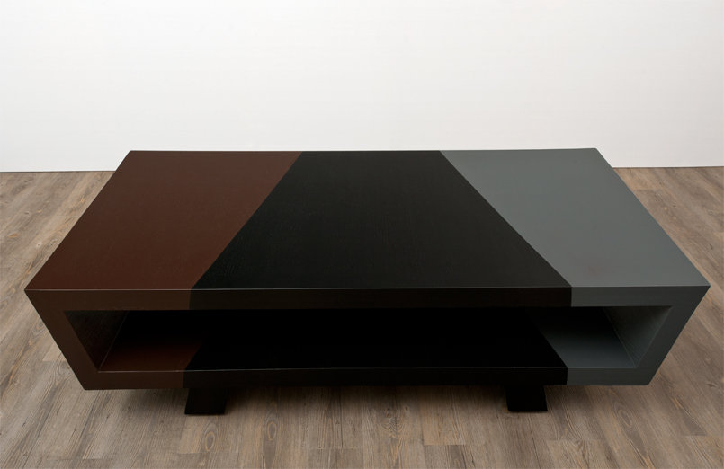 shadows is a black, brown, grey coffee table inspired by the monotone colors and lines that shadows cast.
