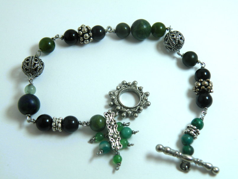 Different shades of jade and black Swarovski pearls bracelet