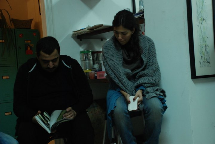 Omar Al Zobi and Muna Amareen exploring a graphic novel