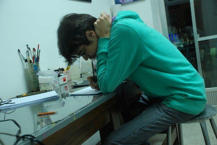 Alaa Alaasadi sketching his characters