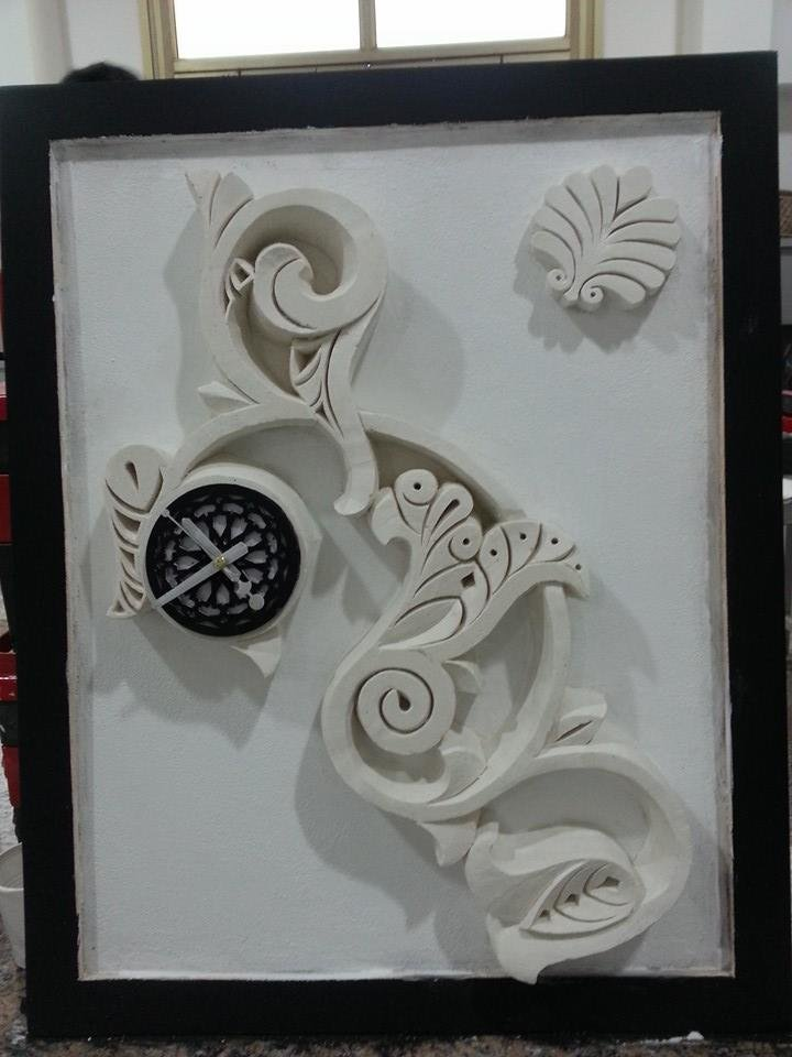 clock design in plaster
