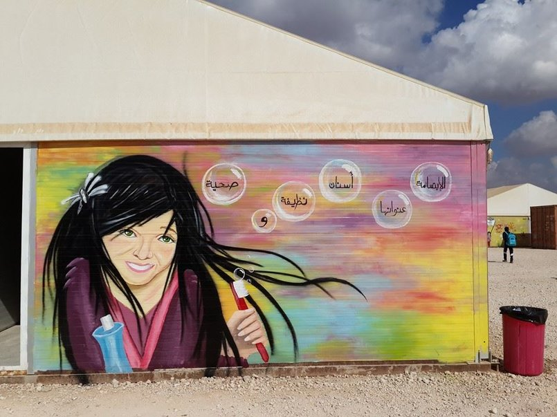 I paint this graffiti in azraq camp / it's about hygiene promotion