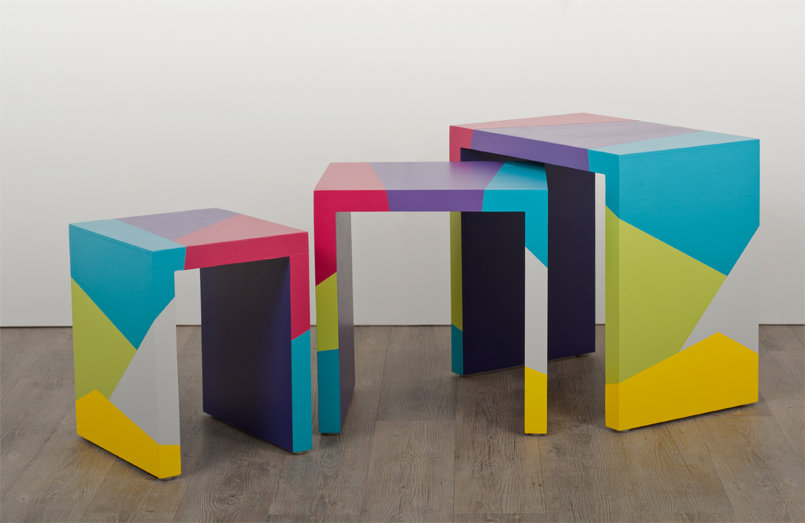 matryoshka is named after the famous Russian dolls. a set of hand painted, texturized bright and colorful nesting tables.