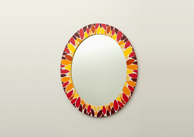 find celina is a feminine light and bright oval shaped hand painted mirror. reminiscent of both summer and autumn.