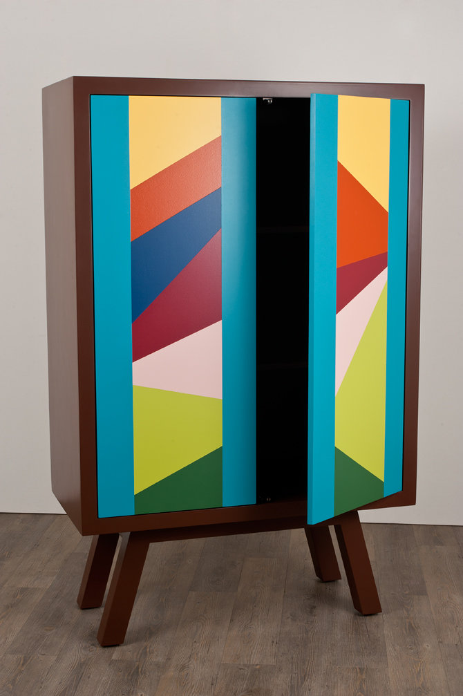 angular tetris is a hand painted geometric and tetris inspired closet with push-to-open magnetic doors.