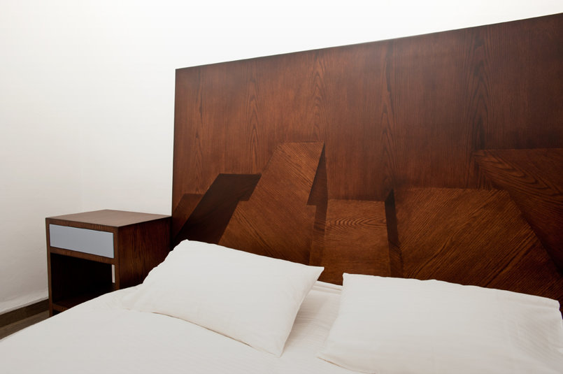 1960 is an architectural wood headboard inspired by visual manhattan back in the mid 1960s. comes with complimentary push-to-open side tables.