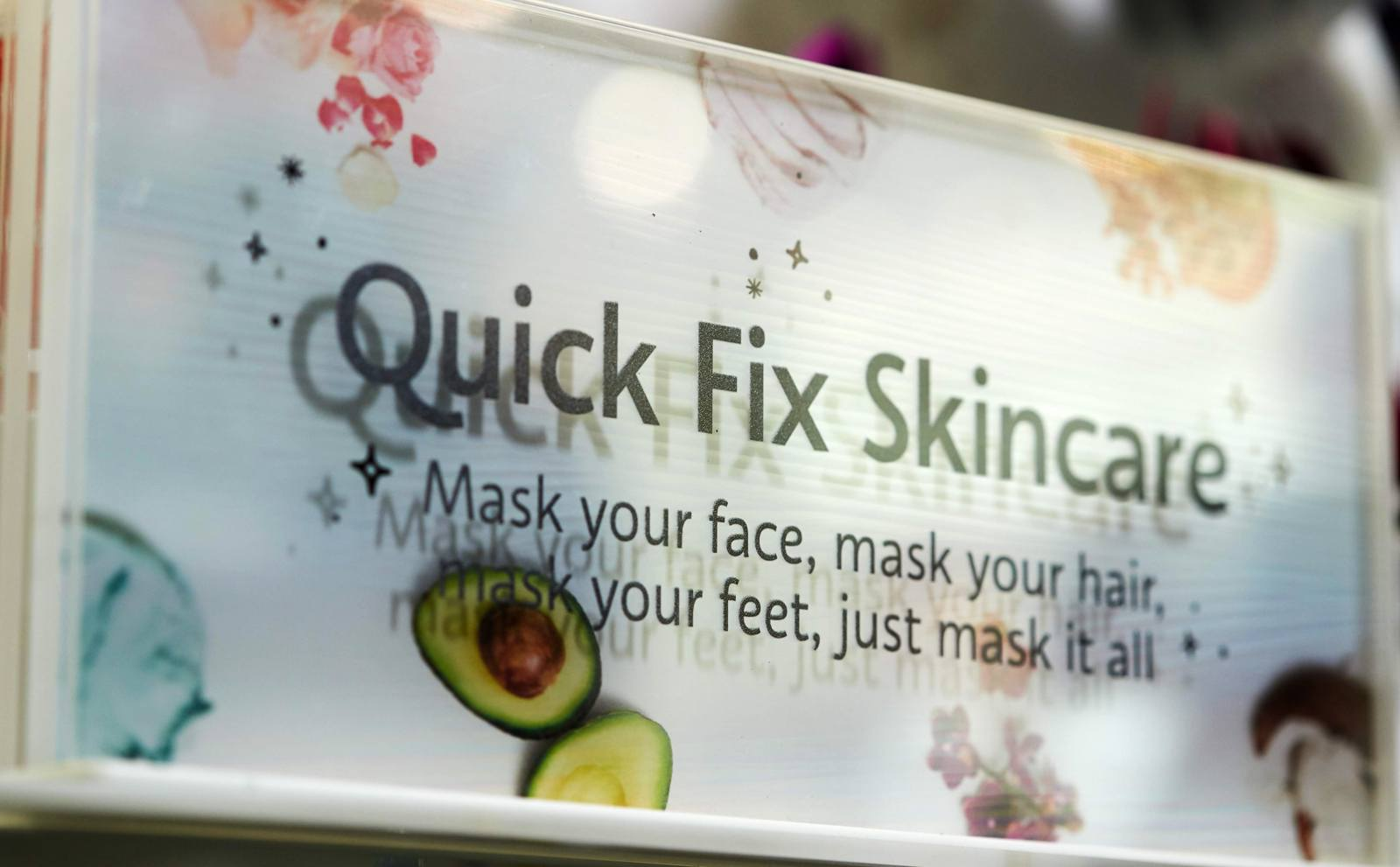 An up-close view of the acrylic signage designed for Sephora's endcap, showing the product ingredients to play up the floating illusion and color palette.