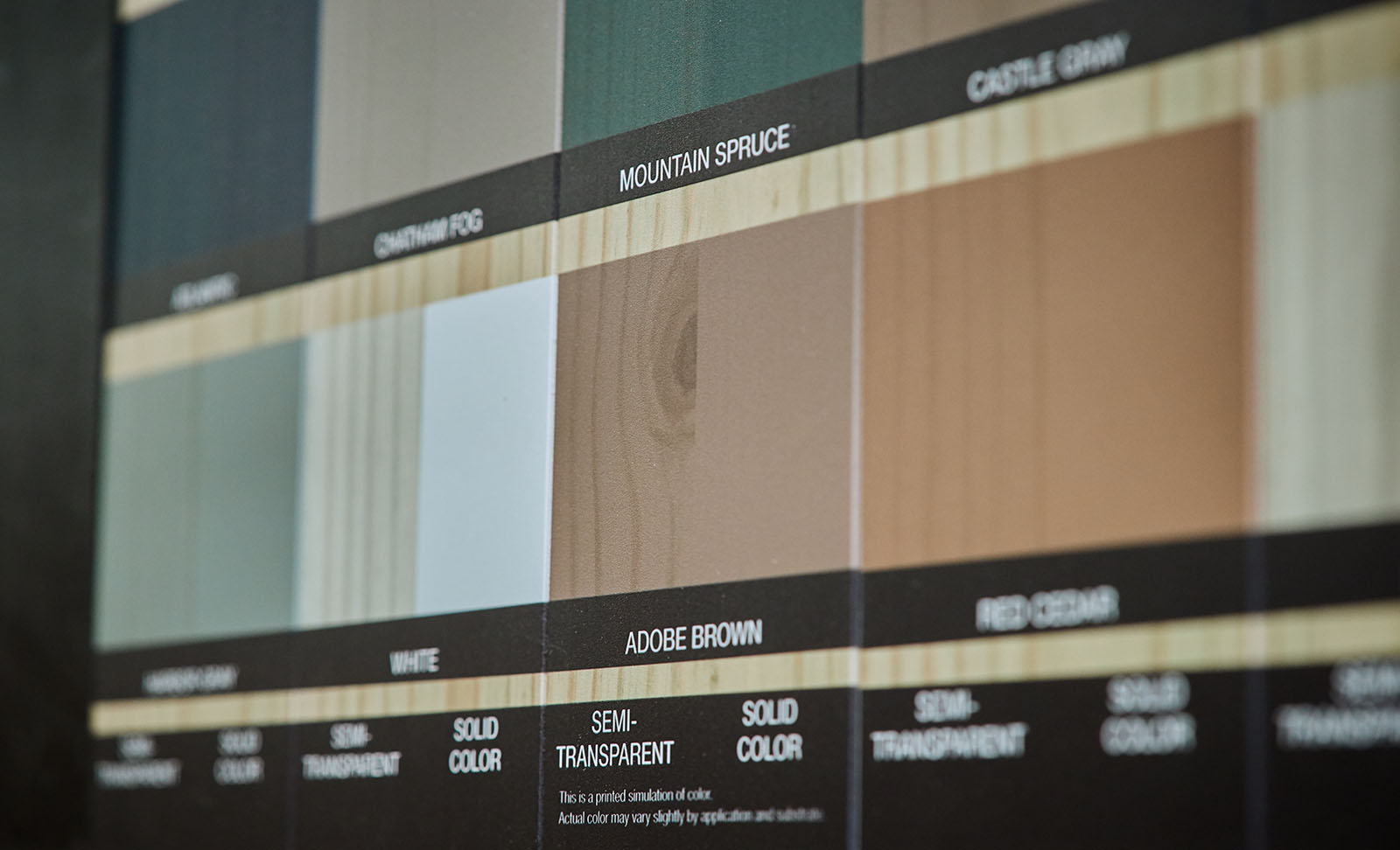 Close up of printed wood stain colors on expanded PVC.