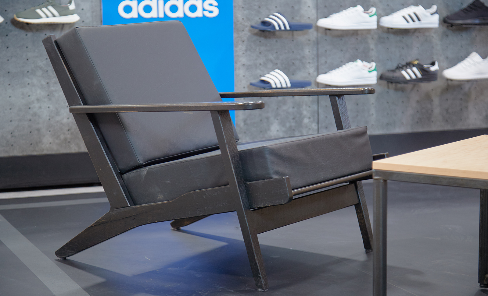 Custom built fixtures lie within the adidas retail space.