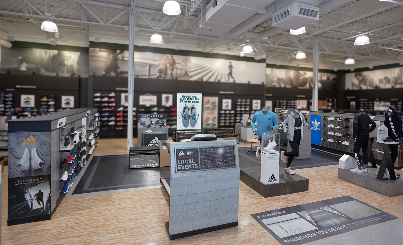 Full view of the custom designed space for Adidas that lives inside a sporting goods store.