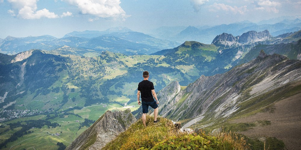 Man standing at edge of moutain