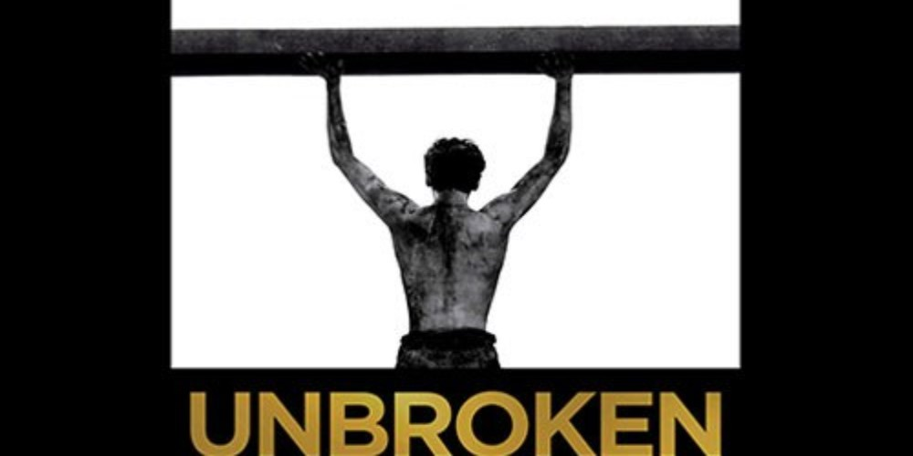 Person holding up beam with the words underneath saying unbroken