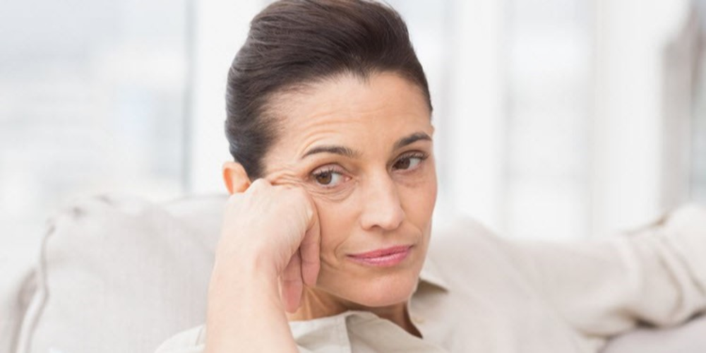 mature woman looking serious