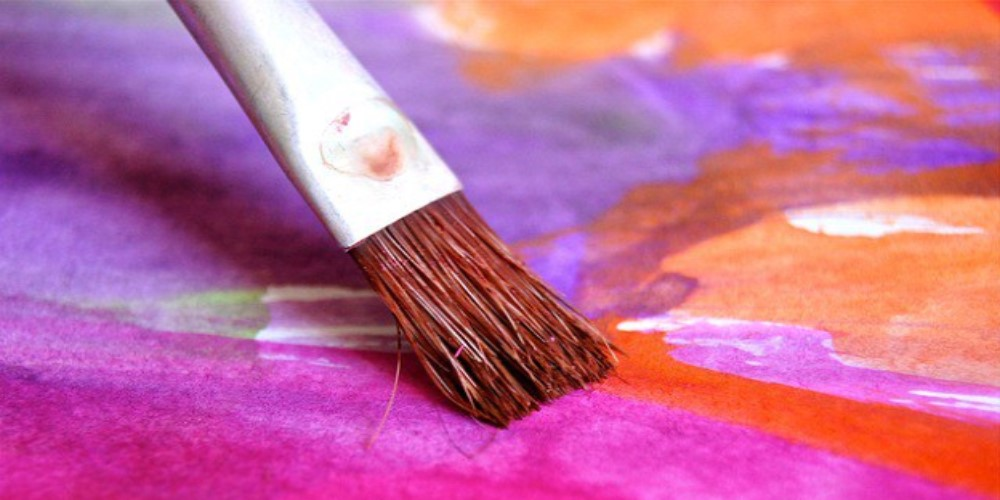 paint brush shown creating a colourful picture