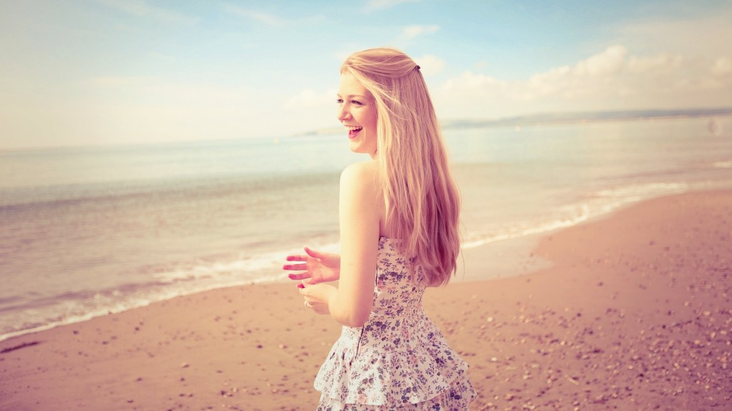 Woman on Beach in Morning, Smiling