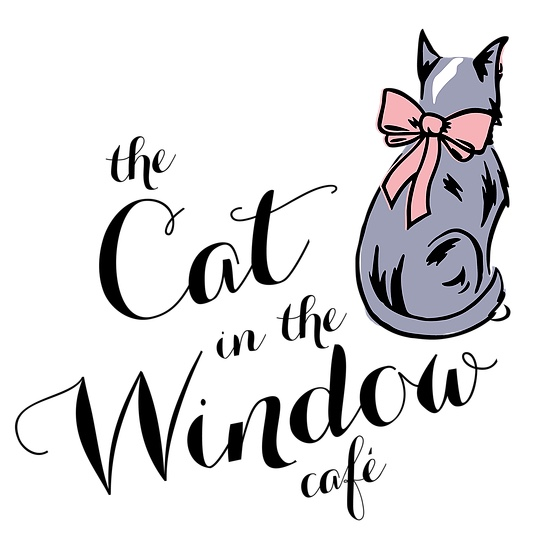 The cat in the window cafe logo
