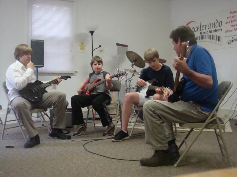 Tracy brothers playing in a group lesson in my Knightdale studio
