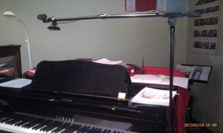 Piano lesson via Skype using overhead webcam suspended from a microphone boom stand