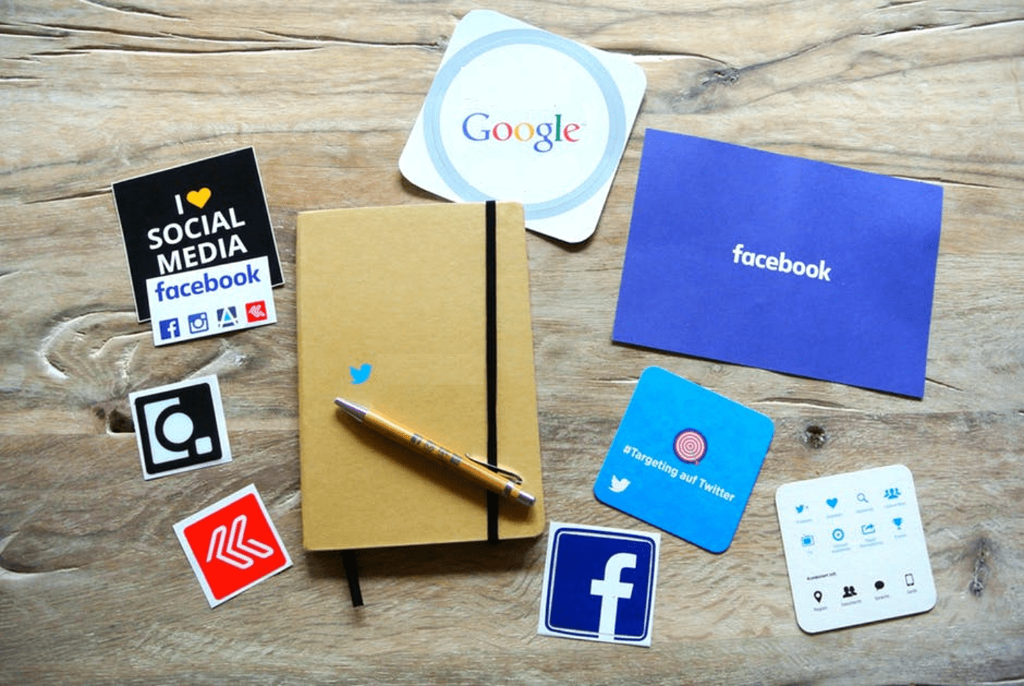 Social media icons near a notebook