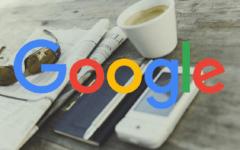 Google icon over newspaper