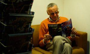 Stan Lee reading comic book