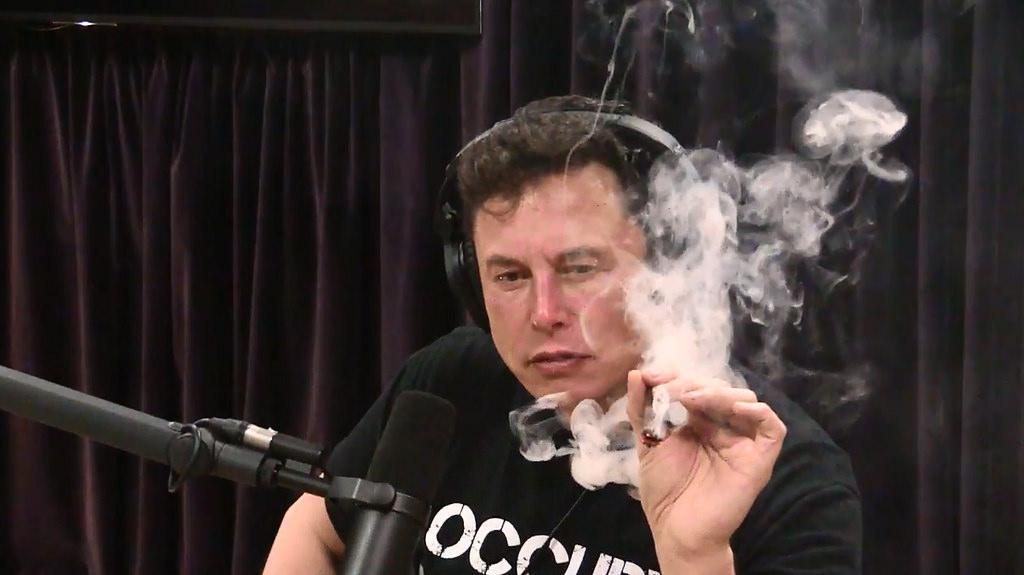 Elon Musk takes a marijuana puff