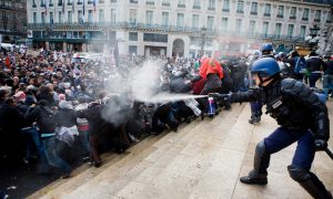 Police men spraying on protesters