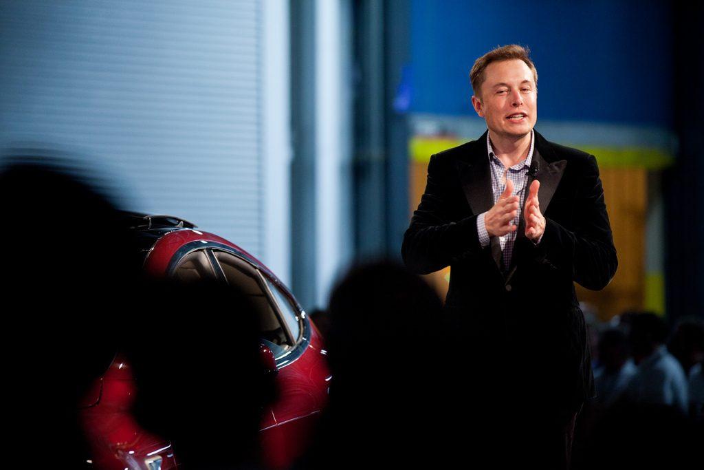 Elon Musk giving a talk at an event