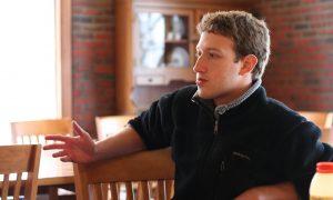 Mark Zuckerberg siting on a chair