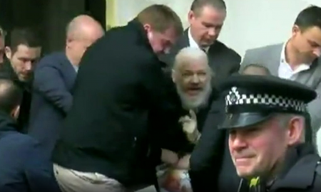 Julian Assange being arrested by UK police outside Ecuador embassy