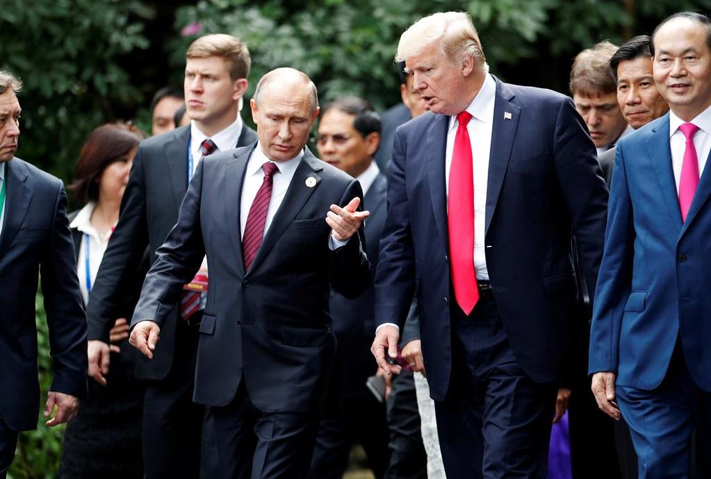 Putin walking with Trump