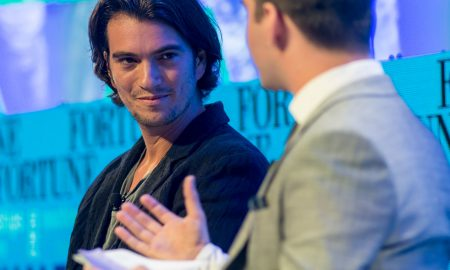 Adam Neumann at a conference