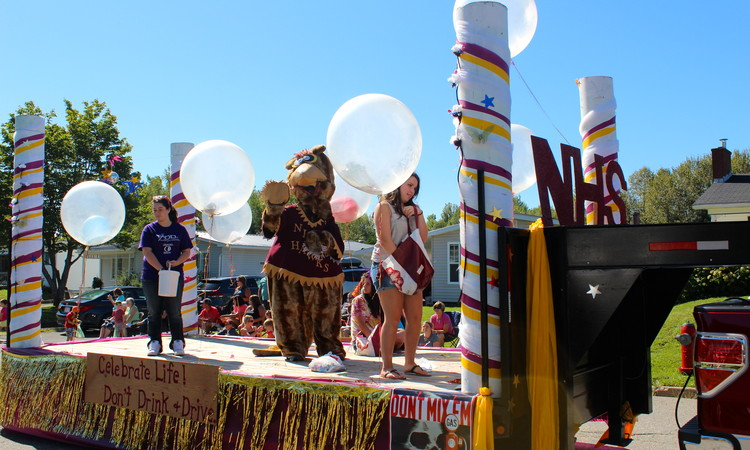 Nackawic High School's mascot, a hawk, waves to the crowd during the 2013  parade at Festival on the Bend in Nackawic. The parade will return this  year on ...