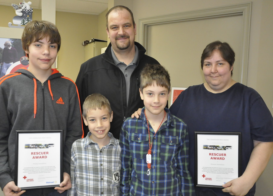 The Soetebeer family poses for a photo. From left are Phillip, Nicholas,  Joerg, Christopher, and Roxana.