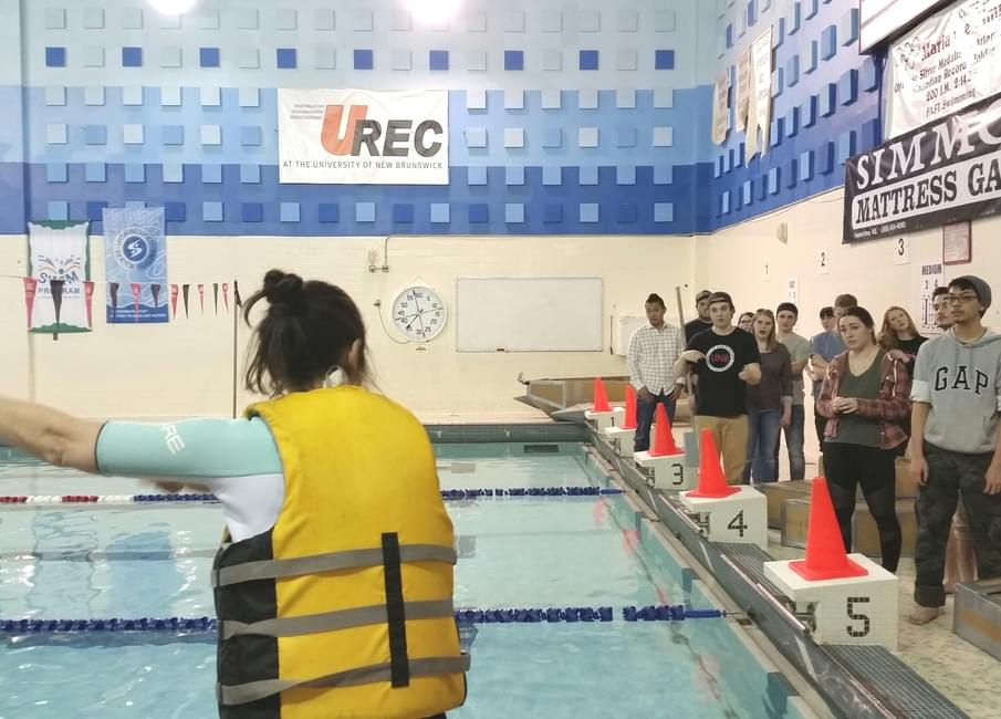 Dr Katy Haralampides Gives Instructions Before The University Of New Brunswicks Cardboard Boat Challenge For Second Year Civil Engineering Students On