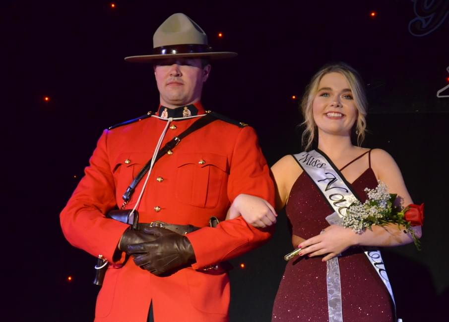 Tim Perry, left, escorts Miss Nackawic 2016 Ashleigh Corey on stage during  the evening gown walk. Corey was named Miss Congeniality.