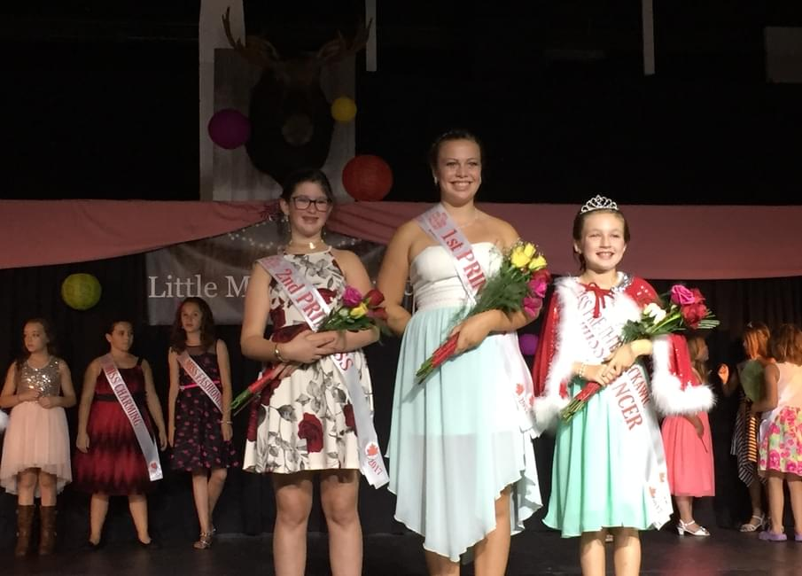The Miss Preteen royal court stands with the rest of the Little Miss  Nackawic contestants in thed background.