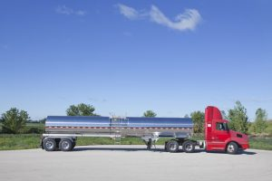 5000 Gal General Purpose Tank Trailer Side with Tractor