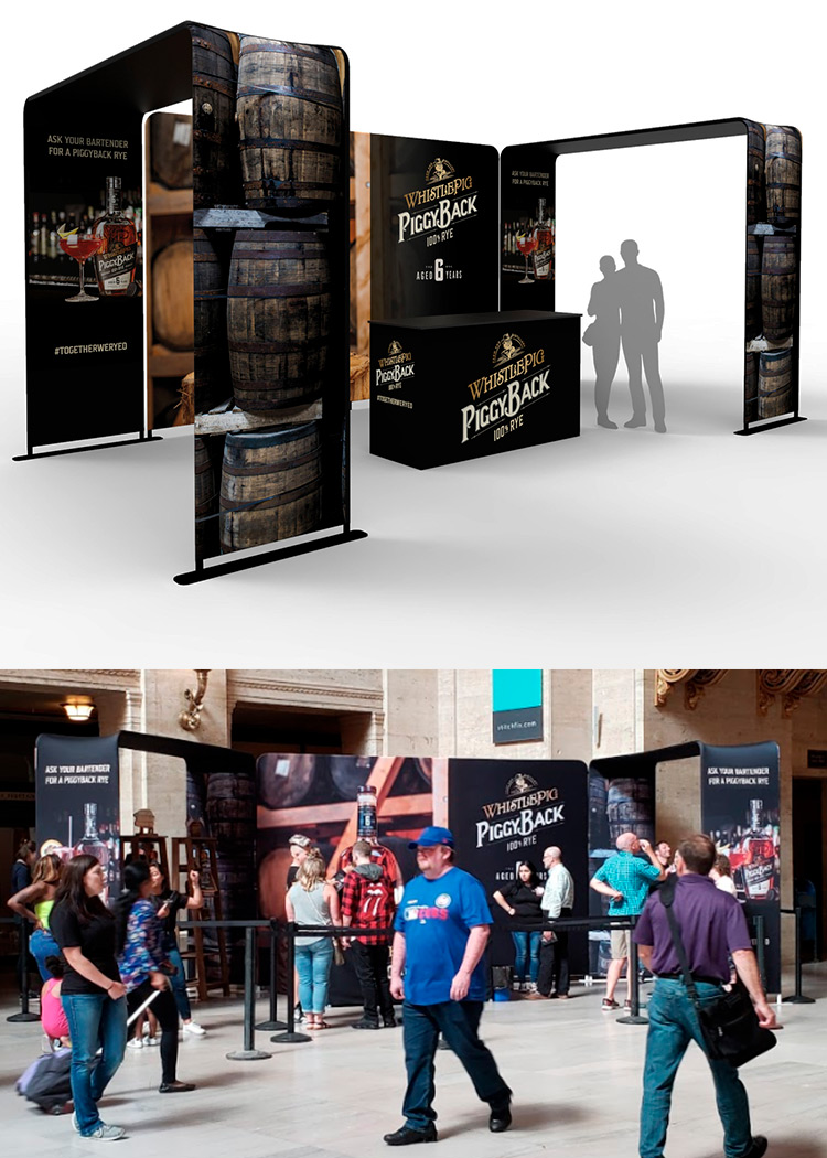 Product sampling pop-up tent with peak banner at event.