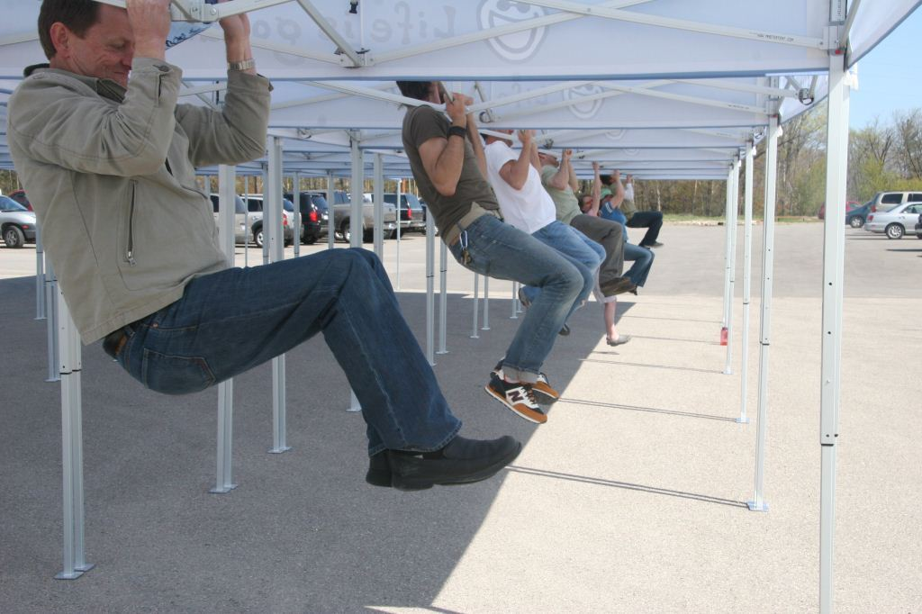 This is what we do to generate a buzz at shows (and show off our sculpted muscles at the same time)