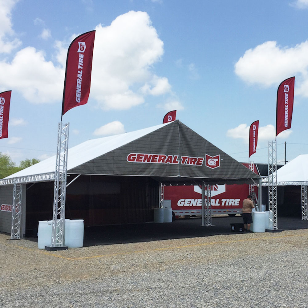 The General Tire Future Trac frame tent with marketing flags attached.