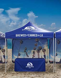 A brewery medium-duty pop-up tent set-up at an event.