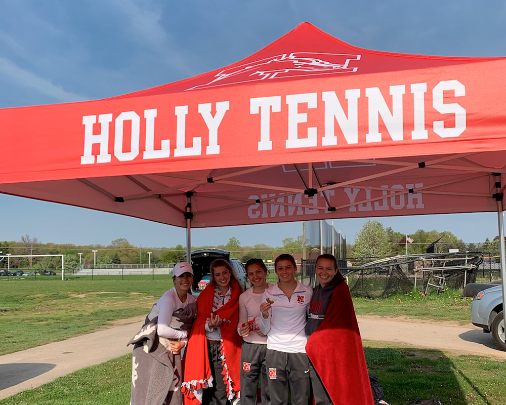 example of UV printing on 10x10 pop up tent canopy for the Holly tennis team