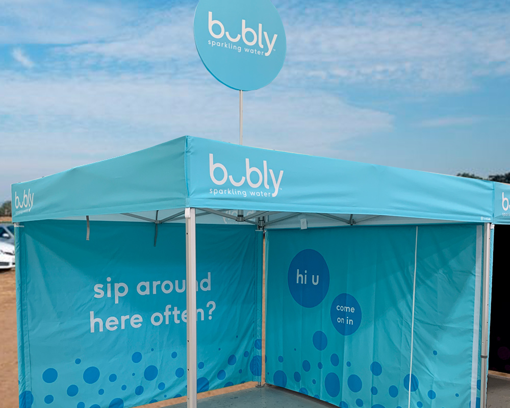 "10x10 pop up tent with flat roof customized for bubly experiential program"" class=""img-fluid customize__img"