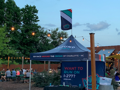 Pop-up tent at an outdoor festival made for 10k race registration.