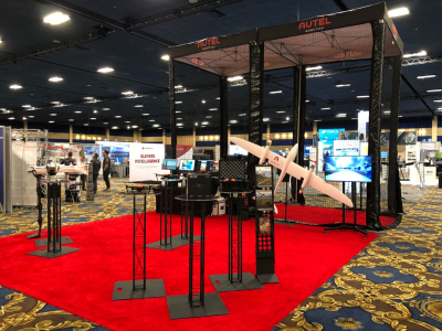 16' tall branded drone cage for indoor demonstrations