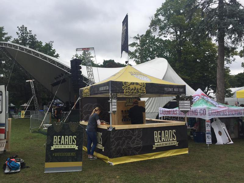 craft beer sampling 10x10 pop-up tent with custom flags, signage and countertops at summer beer festival
