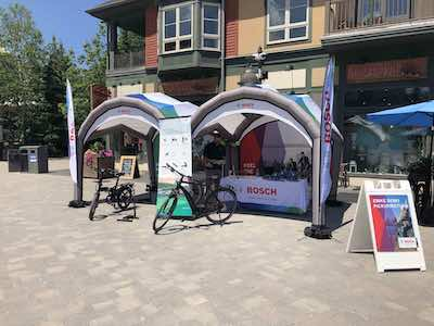 Two inflatable tents side-by-side used for bicycle demonstration.